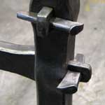 Traditional woodworking wedged joint in steel