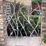 Metal gate made as a plant sculpture