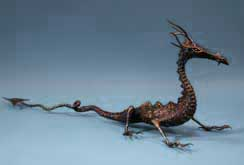 A welded metal dragon sculpture